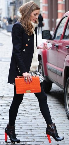 fb13aa5e2ad Olivia Palermo brightens up her outfit as she coordinates boot heels with her  clutch bag