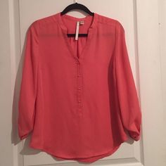 100% polyester salmon colored blouse Salmon colored blouse. 100% polyester. Gold buttons down the front. Took off tags, never wore. Fits closer to a Medium. LC Lauren Conrad Tops Blouses