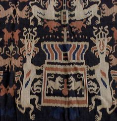 View this item and discover similar for sale at - Large two panel seamed ikat ceremonial cotton hinggi with fringes. Collected in Sumba Indonesia. Traditional indigo background with animal depiction including Textile Design, Textile Art, Ikat, Handicraft, Rugs On Carpet, Indigo, Textiles, Traditional, Quilts