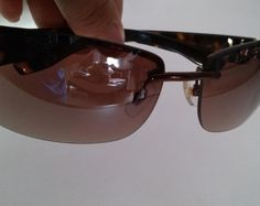 93cca77e811be Óculos de Sol Marrom - Calvin Klein