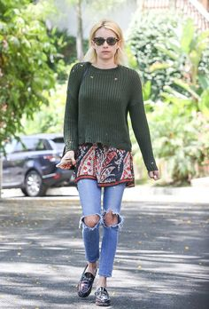 """Emma Roberts shows us that a """"double holes"""" look can be totally cool. She wore her skinny ankle jeans, featuring holes on both knees, paired with a green"""