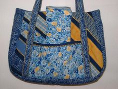 This cute little bag is quilted with 7 different fabrics. The top stitching and quilting stitch is done in Yellow. The lining is blue with two pockets inside and two pockets on the outside. The bag closes with Velcro. This is a medium size bag.Handbag measurements,Top 12 inchesBottom  12 inchesTall 9 inchesWidth across the bottom 4 inchesStraps  26 inches, #zibbet
