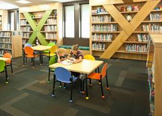 Letters incorporated into shelving design. -  Library Design Showcase 2012: Youth Spaces   American Libraries Magazine