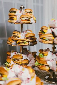 Fun wedding food display - burgers on tiered display {Zelo Photography}You can find Catering food and more on our website.Fun wedding food display - burgers on ti. Pizza Wedding, Wedding Buffet Food, Wedding Reception Food, Wedding Catering, Food Buffet, Wedding Meals, Wedding Food Bars, Party Buffet, Food Ideas For Wedding
