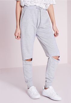 Nail that casual off duty look in these killer ripped knee joggers. Perfect for those lazy sundays and down time, these joggers will be your new go to piece for a casual look. Featuring drawstring detail and cuffed ankles, pair with a plain...