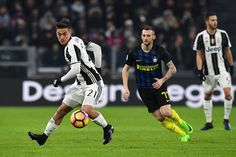 Paulo Dybala (L) of Juventus FC in action against Marcelo Brozovic of FC Internazionale during the Serie A match between Juventus FC and FC Internazionale at Juventus Stadium on February 5, 2017 in Turin, Italy.