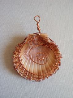 Viking Weave wire wrapped natural shell pendant