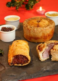 Sausage roll, pork and cranberry pie and pork pie with cranberry and two apple sauces