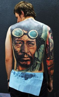 Tattoo living in art. Although I would not want this strange face on my body, the details in this are simply amazing
