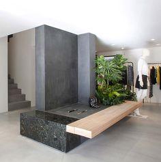 Seoul store || Design: Cigue || Materials: concrete, plaster, sapele wood, steel, and granite