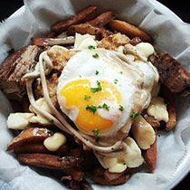 BadHappy Poutine Shop is the only restaurant dedicated to Poutine and other Quebec favorites. Don't forget a cake shake!