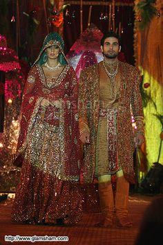Lavish traditional wedding gown and Sherwani by Neeta Lulla