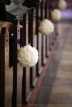 chapel decorations - white pomanders with green ribbon... Looks Familiar! I just made these in deep purple hydrangeas for a friend's wedding!