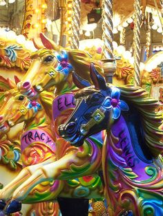 Carrousel horses, fairground, idea of child like feeling when being ridden. Informing print ideas.