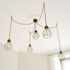 Individual SLÄTTBO cage lights create an expensive-looking cluster pendant.