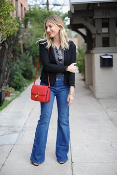 How I'm wearing wide-leg denim, a black tweed jacket, and a red lip.