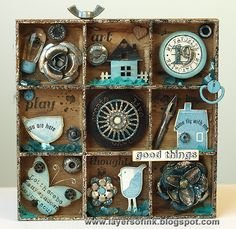Layers of ink: Tiny Stamps and Trinkets Shadow Box, made for Simon Says Stamp & Show. Prima packaging shadow box, filled with small stamps and trinkets, mainly from Hero Arts and Prima (Sunrise Sunset & Junkyard Findings), Stampendous embossing enamels, Tsukineko walnut ink crystals.