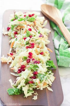 A healthy winter pomegranate cole slaw that's creamy and fresh and ready in under 5 minutes! The recipe uses a greek yogurt sauce as a base and then adds in apple slices, kale, lemon, and pomegranate to create a sweet and mellow sauce drizzled over crisp shredded cabbage and seasonal veggies.