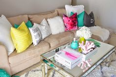 Cutest living room ever. Neutrals and pop of colors