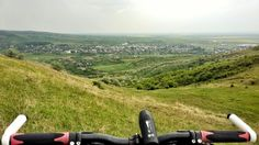 Offroad cycling hilltop view of Urlati, Romania.