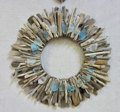 My one-of-a-kind, driftwood wreaths are handcrafted to order, and created with love. They are constructed from unaltered, Maine driftwood (hand selected by yours truly!), then embellished with a combination of turquoise and aqua sea glass pieces.  Sturdy and ready to hang, your custom wreath will make an awesome decoration for any beach cottage or New England style home - Guaranteed to add a beachy touch to any room, just wait and sea! (Sorry, I had to.)  ~ If youd prefer, these wreath…
