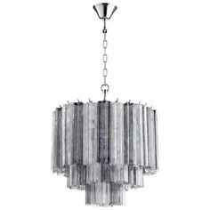 Cache Chandelier- Avail for Purchase at BWC Studio,  Modern Pendant in Clear and Smoke Glass Star Shaped Tubes. Silver Hardware Holds 3 B Lamps- 60 Watts Each and 1 A Lamp- 60 Watts (Not Included) #GlassChandelier #BwCollier #BWCStudio #Houstondesign