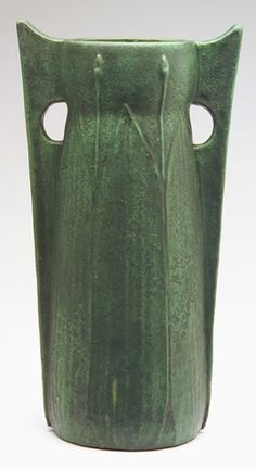"""WHEATLEY Floor vase with full-height buttressed handles and tall molded leaves alternating with buds, covered in a fine, frothy matte green glaze. WP 623. 19 1/2"""" x 10 1/2"""""""