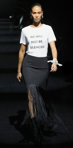 The designer sent models down the runway with a strong feminist message. from Essence.com
