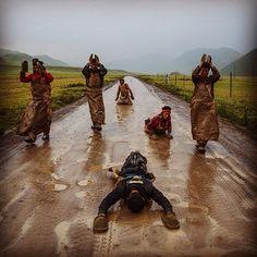 yamashitaphoto~~ Pilgrims prostration prayer along the Tea Horse Road to Lhasa. #Tibet #Shangrila #natgeo @thephotosociety