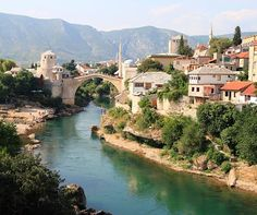 Visit the city sights of Mostar, a city on the Neretva River in Bosnia and Herzegovina. On this day trip from Dubrovnik, see the Old Bazaar, the Turkish House and historical mosques. After a guided tour of town, you will have free time to visit the o Lonely Planet, Places To Travel, Places To See, Bosnia Y Herzegovina, Honeymoon Destinations, Honeymoon Planning, Honeymoon Ideas, Round Trip, Montenegro