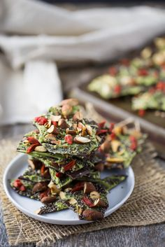 This Dark Chocolate Almond Superfood Bark is loaded with healthy ingredients like matcha, goji berries, and chia seeds. Makes a great homemade holiday gift!