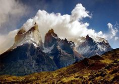 Chile.  These massive granite peaks are called Torres del Paine (Towers of Paine) and are located in Torres del Paine National Park in Patagonia, chile.
