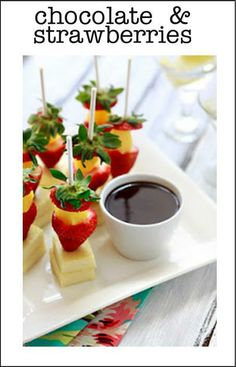 Let's dip us a little strawberry and cake into chocolate!  Excellent party food
