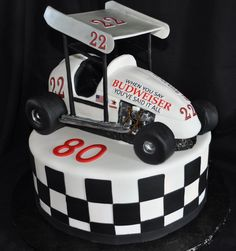 sprint car - This was made for an 80 year old man that back in the day he raced sprint cars. This was so fun to make. Car is chocolate cake. Wing on top is gumpaste. Wheels are rice krispies
