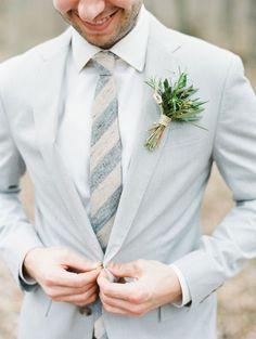 Light gray and pastel groom attire for a summer wedding