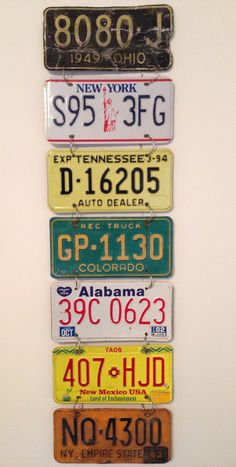get a bunch of old license plates and attach them to each other using binder rings, and then hang them on your wall! such a cute idea
