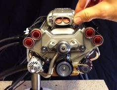 A model engine with electronic fuel injection, a engine in generation Corvette models, built from scratch. Have a look at the video and what a mini sounds like. Corvette, Planes, E Motor, Rc Cars And Trucks, Small Engine, Cool Tech, Car Engine, Mechanical Engineering, Small World