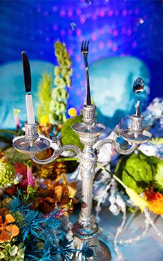 """Instead of candles, we've topped off the candelabras at this wedding reception with Ariel inspired """"dinglehoppers"""""""