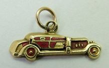 Sandys Vintage Charms :: A 1920s/30s European 12ct gold and enamel car charm that opens to reveal two red hearts inside, SUPERB, some damage to the enamel but SUCH a RARE piece!