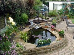 Beautiful Backyard Makeovers: The island in the middle of the patio is the focal point of the yard, and the water feature is its showpiece. Description from pinterest.com. I searched for this on bing.com/images