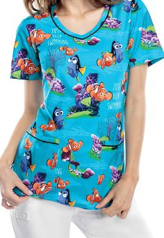 Just Keep Swimming with this adorable Cherokee Tooniforms Finding Nemo print scrub top | Scrubs & Beyond