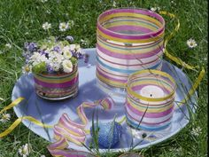 Make an indoor or outdoor centerpiece for your Easter brunch. Glass cylinders from JoAnn Stores or Michaels, check out the dollar stores too. You'll be amazed at what's available. Cover the glass with Mod Podge or watered down white glue. Add crepe paper streamers in Easter colors and allow to dry. Place votive candles or pillar candles inside. White candles are fine but try pillars in Easter colors as well, like pink, lavendar, purple, light blue and teal. We have them at…