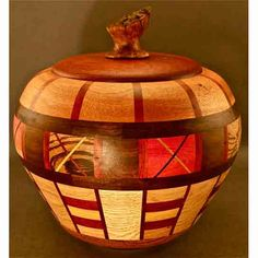 Winchester Woodworks creates this Lidded Urn. Now known for his focus on polychromatic segmented woodturning, Alan Davis' latest series involves the use of native hardwoods, (cut from his own 10-acre