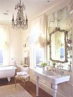antique mirror glass - the whole room - gorgeous! I would love to have a bathroom with a chandelier!