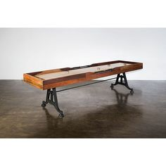 """Let the games begin! The 9"""" Shuffleboard Gaming Table is not only a great way to get your friends and family around for a fun game, it also is a attractive addition to any room it's put in. This Shuffleboard is made with only the highest quality materials, like solid reclaimed wood with a burnt umber finish and a durable cast iron base. Order your 9"""" Shuffleboard Gaming Table today and update your home with something the whole family can enjoy!"""