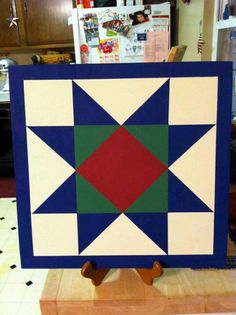 A beautiful wooden quilt block to adorn a barn