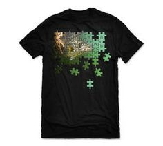 """Piecing The Puzzle Graphic Tee Big Bass Dreams   What greater puzzle is there for a fisherman than figuring out how to target, coax a bite from, AND successfully land a fish of a lifetime?  That's the premise behind our LIMITED Edition """"Piecing The Puzzle"""" Graphic Tee.  Each day we spend on the water looking for the fish DREAMs are made of is always a new challenge, a new puzzle to piece together.  Feel accomplished when you do realize that dream, you earned it."""