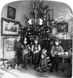 "Image title: Lyndhurst – a happy Christmas at ""Woody Crest,"" December, 1905.    Summary: Five boys in costumes, with toys, in front of Christmas tree, Lyndhurst school, Tarrytown, N.Y."
