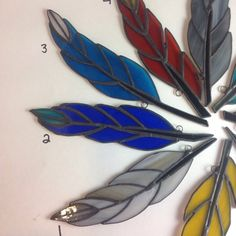 Stained Glass Feathers New Flock of Handcrafted Natural Tones and Bold Tropical Colors Dove Bluebird Canary Cardinal Stained Glass Tattoo, Stained Glass Cookies, Stained Glass Door, Stained Glass Ornaments, Stained Glass Birds, Stained Glass Christmas, Stained Glass Suncatchers, Stained Glass Designs, Stained Glass Panels