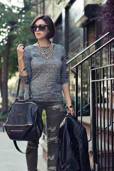 camo pants with gray sweater and black leather jacket - very classic - and I think this would work for the over 40 crowd too.